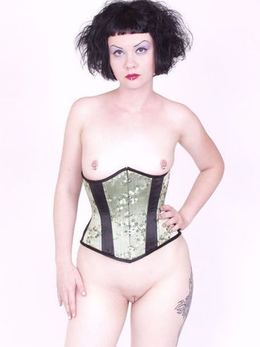 Brunette haired goth girl Verotika in corset and boots loves showing off her clean pussy