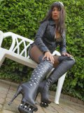 Foot & legs loving queen Stella Van Gent poses in her favorite pair of knee high boots.