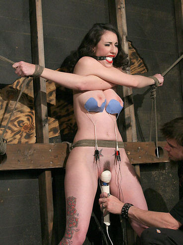 Natalie Minx finds her big boobs and neat pussy tortured hard in a bdsm dungeon