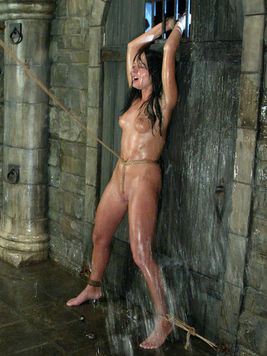 Ball gagged brunette Melissa Lauren gets caned and water tortured by inhuman Princess Donna