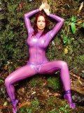 Huge titted redhead beauty Bianca Beauchamp strips out of her rubber suit by the waterfall