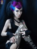 Blue-haired gothic model Razor Candi dressed in back shows her private parts