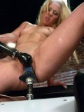 Sexy Holly Hanna screams with pleasure as she gets double penetrated by the machine.