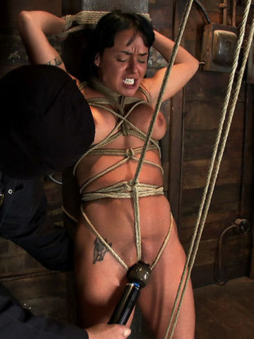 Pretty brunette Mahina Zaltana with big boobs gets tied up and her pussy is stimulated with a toy.