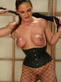 Venus teams up with another domina Audrey Leigh in fishnets and corset to punish Bob Crane
