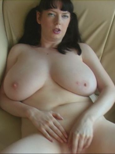 Pigtailed BBW brunette Emily Cartwright with big tits and pink pussy takes off her lingerie