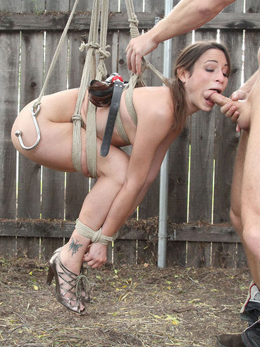 Amber Rayne gets tied up and ruthlessly fucked in the backyard and indoors