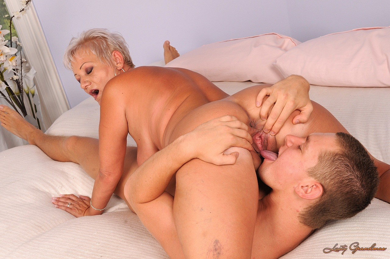 image Hungry milf seduces young brunette to fuck her in bed