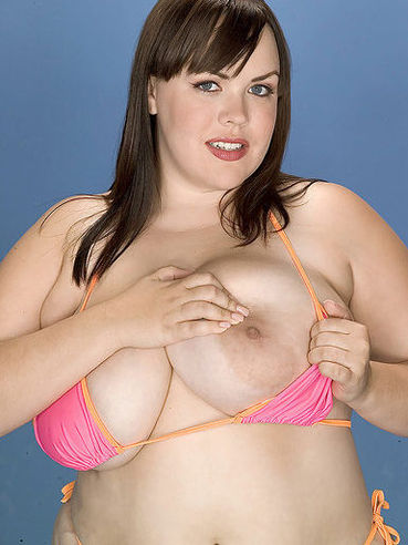 Chubby Isabell Lane with fat ass and enormous tits poses in tiny pink bikini