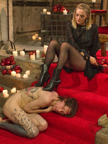 Mona Wales making her FemDom slave moan and scream while pushing rods into his cock.