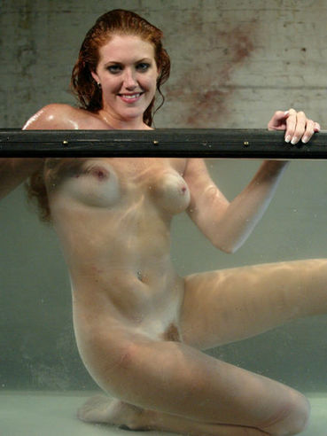 Curly-haired redhead bondage girl Sabrina Fox with nice ass gets the water punishment
