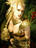 Bosomy blonde warrior Victoria Blue takes off her golden outfit and shows off her curves naked