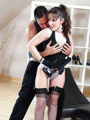 Cate Harrington in stockings and gloves gives mouth job to handsome stud