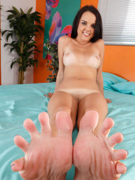 Hot fetish model Dillion Harper is showing off her foot and legs while posing nude.