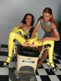 Gina LatexSlutShow in yellow latex opens her legs for kinky Janine La Teen on the exam chair