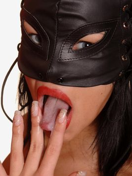 Dominating masked woman Virginiee in black leather suit uses hard dick of her slave boy
