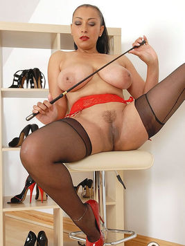 Big breasted mistress Donna Ambrose in stockings spreads her legs and exposes her snatch