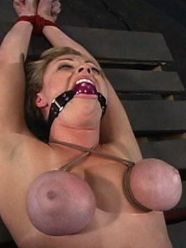 Adrianna Nicole gets her boobs bound and flogged in an inverted suspension by Chanta Rose