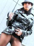 Stella Van Gent min see through pantyhose and short black coat reveals her pussy under umbrella