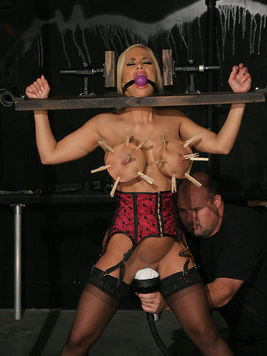 Slave blonde Shyla Stylez gets her juggs and vagina punished after hot wax torture