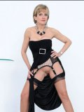 Mature woman in black Lady Sonia demonstrates her big breasts and snatch