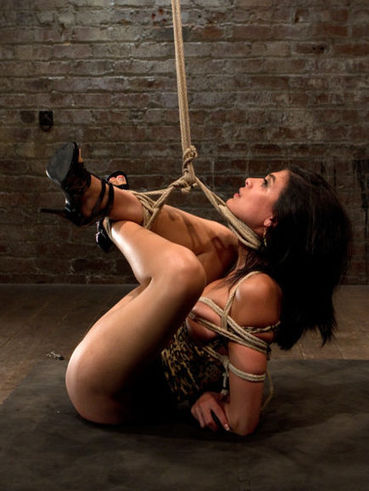 Gagged beauty Heather Vahn gets her big red nipples clasped and her body restrained with ropes.