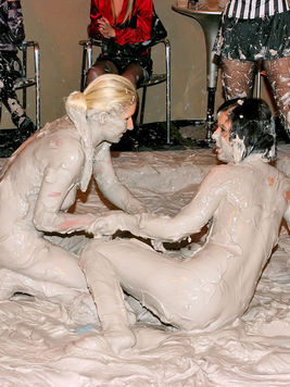 Party lady Rihanna Jamuel and her opponent remove each others clothes wrestling in the mud