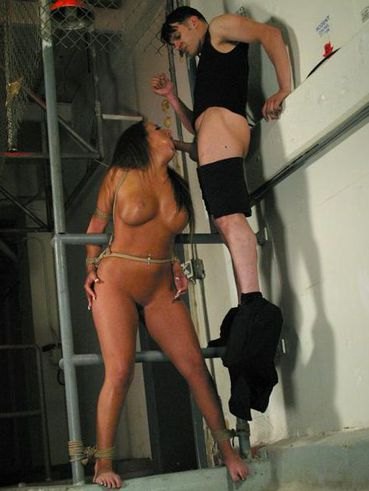 Raven haired slave woman Richelle Ryan with amazing tits and ass gets her pussy penetrated