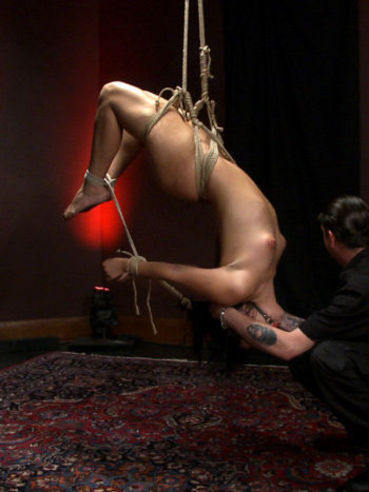 Ashli Orion gets gagged and her nipples are teased while she is stretched hard in bondage.