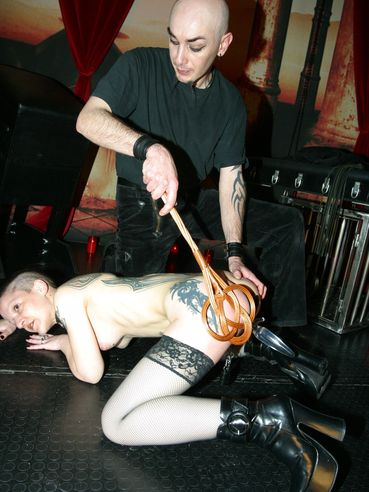 Inked up short haired slave Tamina in stockings gets whipped and tortured