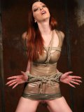 Long haired redhead Emily Marilyn in see through skin tight rubber dress gets rope bound