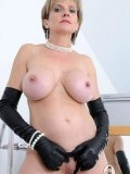 Round boobed mature model Lady Sonia loves black clothes and high heels