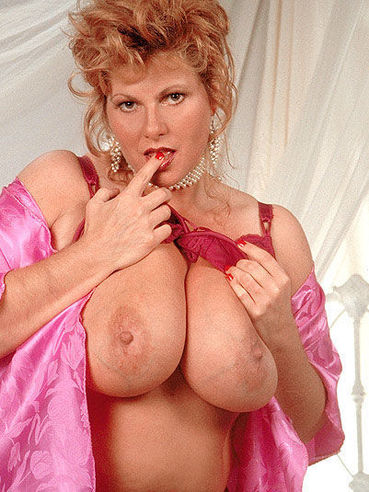 Plump middle aged woman Mindy Jo in red lingerie displays her huge jugs
