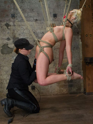 Horny blonde Tara Lynn gets tied up, gagged and her mistress plunges her wet hole with a toy.