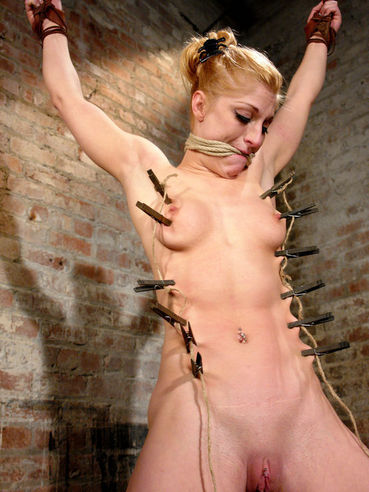 Bound tight bodied slave girl Tawni Ryden gets her pussy and feet punished hard