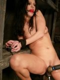 Ball gagged Roxy DeVille gets her snatch pleased by robotic dildo and vibrator