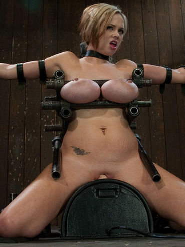 Katie Kox gets her monster pierced tits clamped and caned with no mercy.