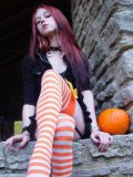 Liz Vicious is a naughty pumpkin girl who loves spreading her white thighs and showing off her cunt