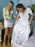 Bride Kitty Saliery and a crazy blonde get messy on a bed and remove their dirty clothes