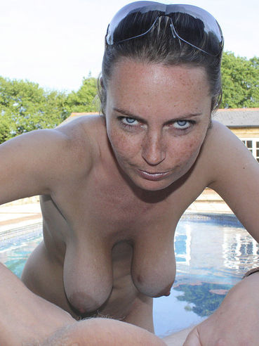 Alexis May with big natural tits goes topless and punishes a cock at the poolside
