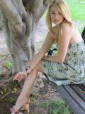 Shoeless blonde Kelly Space in nice summer dress shows off her lovely feet outdoors