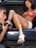 Leggy chick Melanie Jolie touches her shaved pussy as man fucks her feet in the back of a car