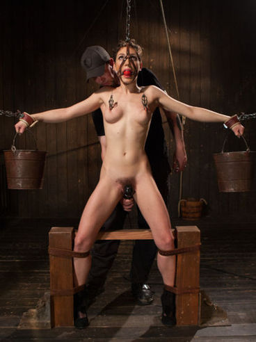 Lily Labeau gagged and gets her hairy muff stimulated and drilled up while in kinky bondage.