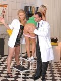 Sabrina Blond takes off her light pink panties for spanking loving doctor and nurse Niki Sand
