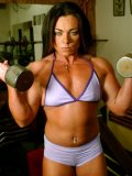 Bodybuilder Kim Bruno in sexy uniform works out at the gym and flashes her small tits