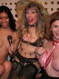 Ladies show their boobs to Susan Block and her friend Rom Jeremy at insane fetish party