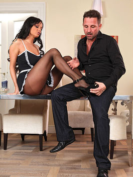 While wearing a kinky maid uniform Sheila Grant makes her master's cock hard with her feet.