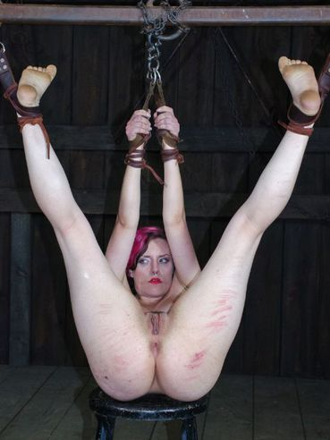 During hardcore BDSM the pink haired babe Iona Grace is made to moan and scream while stimulated.
