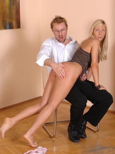 Leggy blonde Helena Sweet takes off her panties and gets her charming ass spanked by glassed man