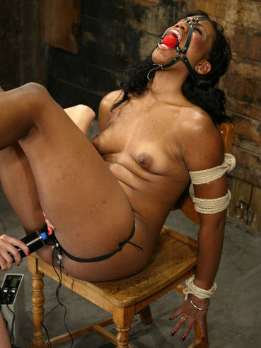Chocolate slave Sydney Capri gets her tiny nipples and tight holes punished
